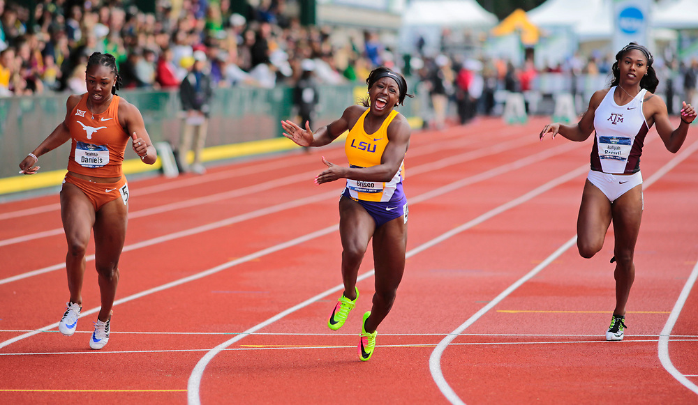 LSU's Mikiah Brisco, center, celebrates as she crosses the finish line ahead of Texas' Teahna Daniels, left, and Texas A&M's Aaliyah Brown, right, to win the women's 100 meters in the time of 10.96 seconds, on the final day of the NCAA outdoor college track and field championships in Eugene, Ore., Saturday, June 10, 2017. (AP Photo/Timothy J. Gonzalez)