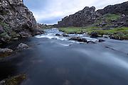 Öxarárfoss is a waterfall in Þingvellir National Park, Iceland. It flows from the river Öxará over the Almannagjá canion.