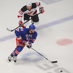 May 14, 2012: New York Rangers center Brad Richards (19) skates down ice with New Jersey Devils right wing David Clarkson (23) in pursuit during third period action in game 1 of the NHL Eastern Conference Finals between the New Jersey Devils and New York Rangers at Madison Square Garden in New York, N.Y. The Rangers defeated the Devils 3-0.