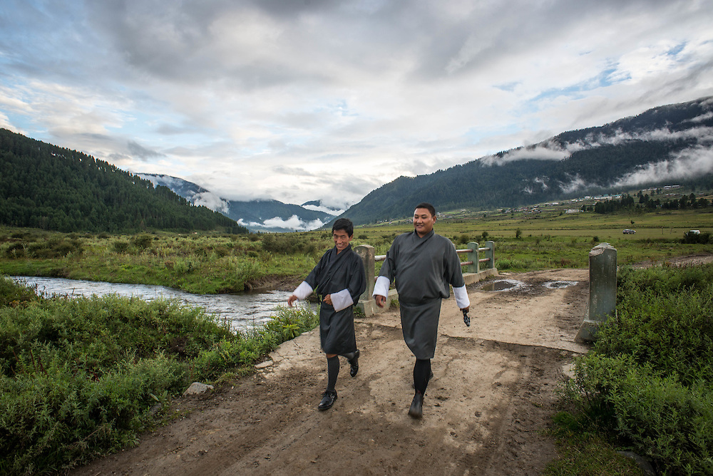 Two Bhutanese men walking in the countryside<br />
