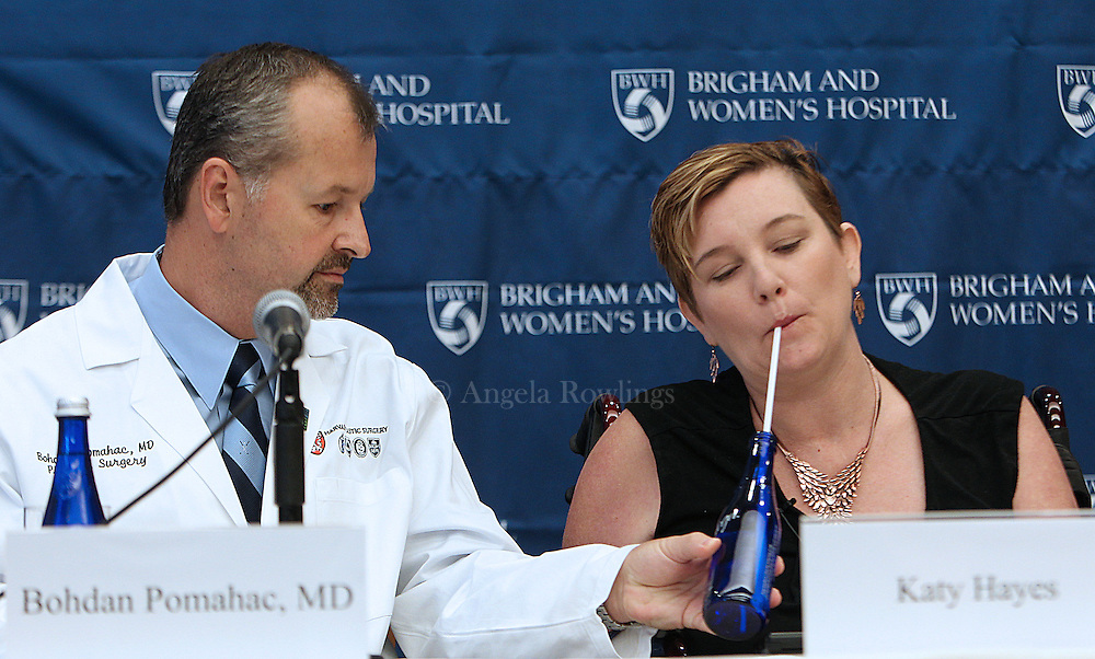 (091212  Boston, MA) Quadruple amputee Katy Hayes gets help with her water from Dr. Bohdan Pomahac during a news conference announcing that Hayes will receive an arm transplant at Brigham and Women's Hospital, Wednesday,  September 12, 2012. Staff photo by Angela Rowlings.