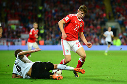 Ben Woodburn of Wales is challenged by Stefan Llsanker of Austria - Mandatory by-line: Dougie Allward/JMP - 02/09/2017 - FOOTBALL - Cardiff City Stadium - Cardiff, Wales - Wales v Austria - FIFA World Cup Qualifier 2018