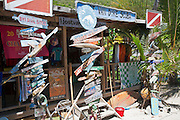 Dive shop sign made of pieces of driftwood in White Bay on Jost Van Dyke BVI