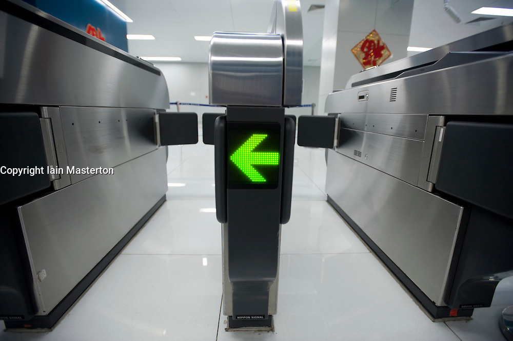 Detail of modern ticket barrier machine at station on Airport Express railway station in Beijing China