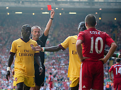 15.08.2010, Anfield, Liverpool, ENG, PL, FC Liverpool vs FC Arsenal, im Bild Liverpool's Joe Cole is shown the red card by referee Martin Atkinson against Arsenal. EXPA Pictures © 2010, PhotoCredit: EXPA/ Propaganda/ David Rawcliffe / SPORTIDA PHOTO AGENCY