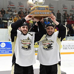 TRENTON, ON - Apr 22, 2016 -  Ontario Junior Hockey League game action between the against the Trenton Golden Hawks and the Georgetown Raiders. Game 5 of the Buckland Cup Championship Series, at the Duncan Memorial Gardens in Trenton, Ontario. Danny Hanlon #27 and Adam Clements #20 of the Trenton Golden Hawks hoist the cup.<br /> (Photo by Andy Corneau / OJHL Images)