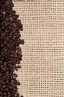 Coffee Beans and Burlap Background with copyspace.