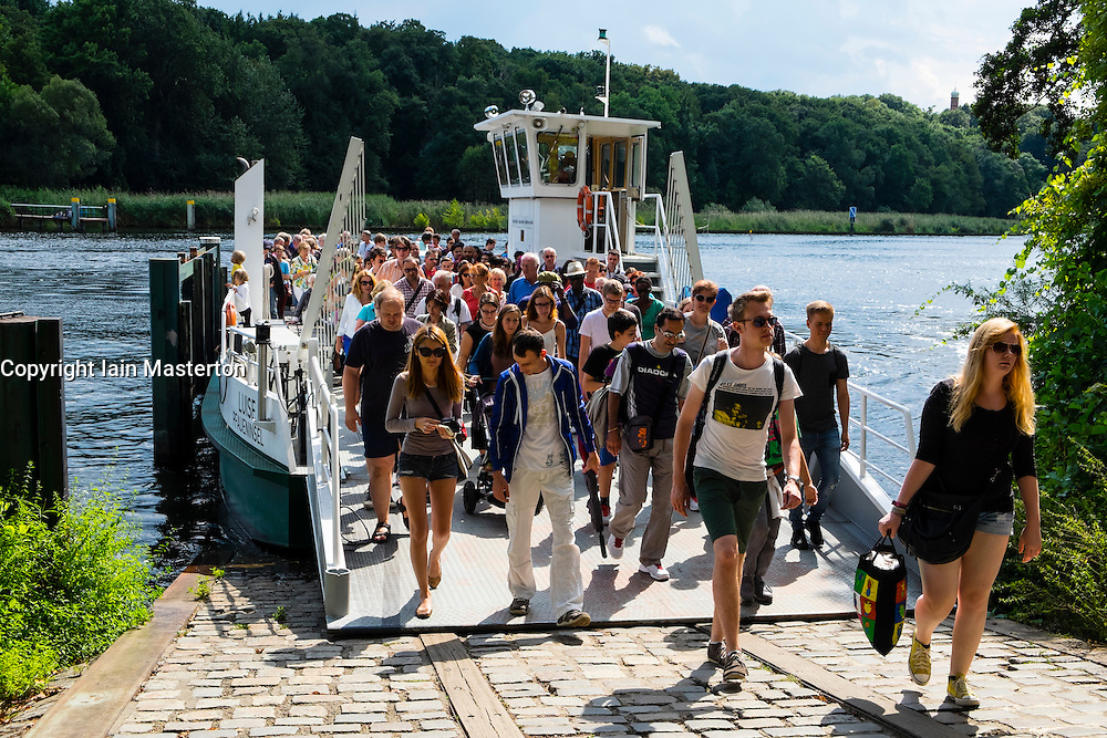 Ferry arriving with visitors to Peacock Island (Pfaueninsel ) a UNESCO world Heritage Site  in Berlin Germany