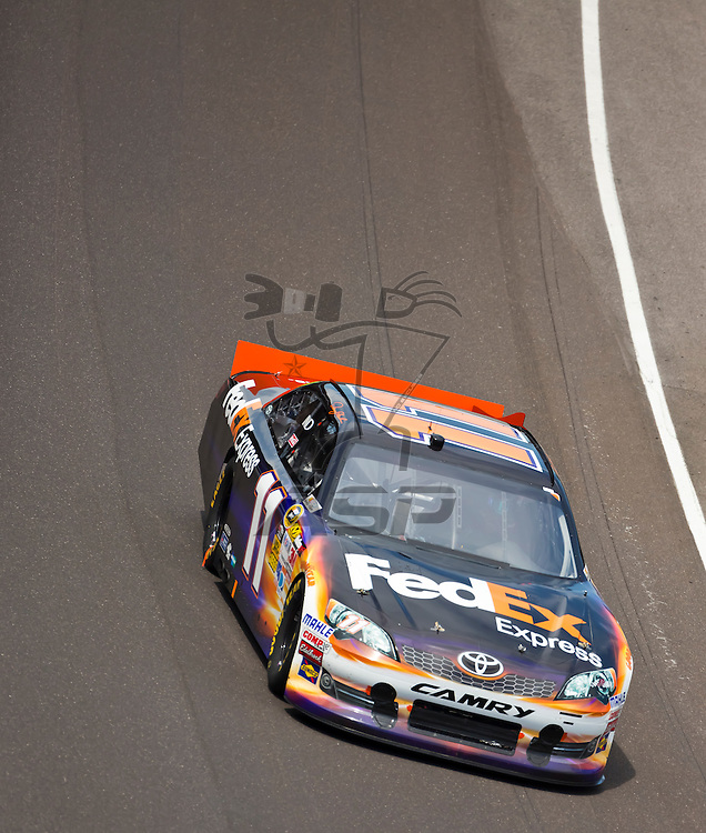 INDIANPOLIS, IN - JUL 29, 2012:  Denny Hamlin (11) brings his car down the front stretch during the Curtiss Shaver 400 presented by Crown Royal Sprint Cup Series race at the Indianapolis Motor Speedway in Indianapolis, IN.