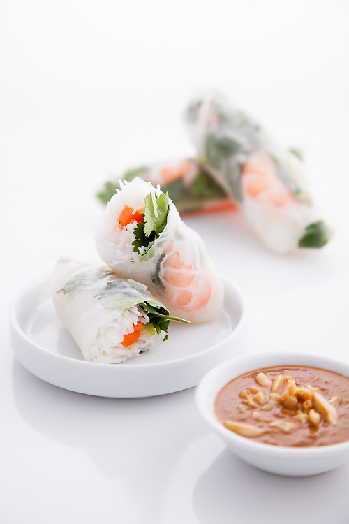 Shrimp spring rolls with spicy peanut sauce.