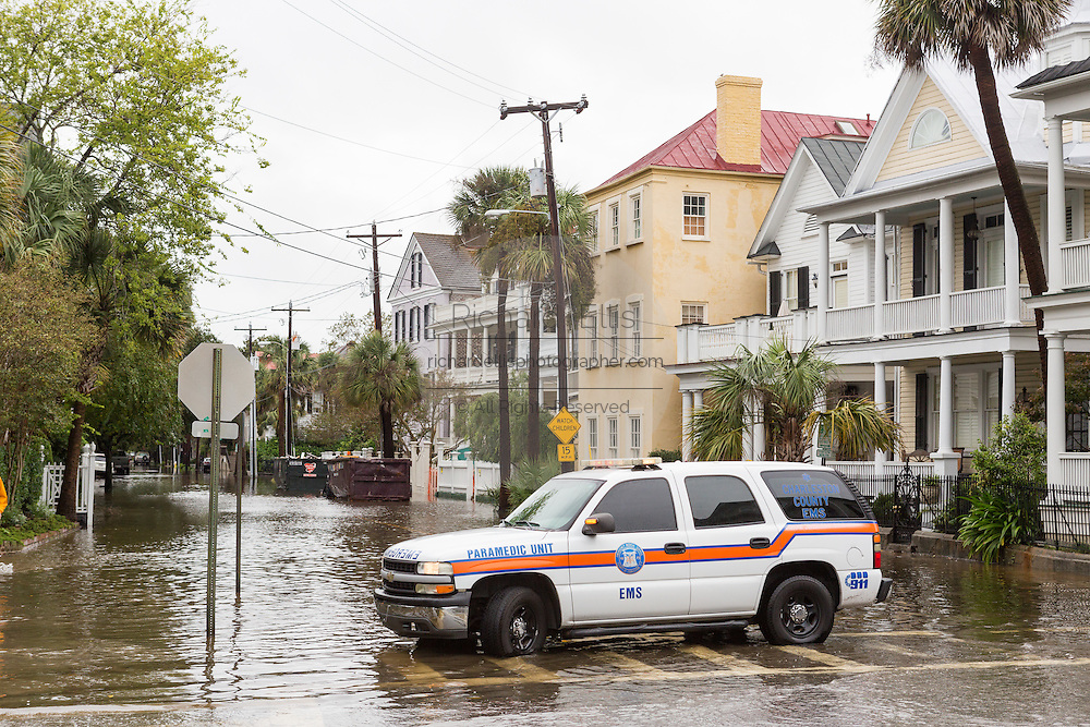 An emergency vehicle blocks a flooded street in the historic district as Hurricane Joaquin brings heavy rain, flooding and strong winds as it passes offshore October 4, 2015 in Charleston, South Carolina.