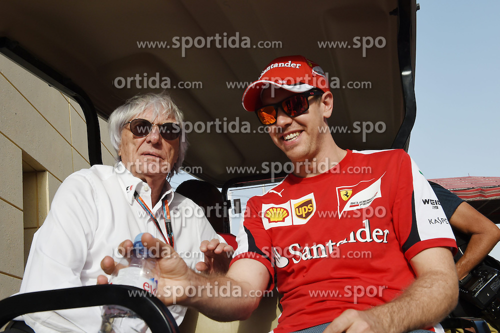 18.04.2015, International Circuit, Sakhir, BHR, FIA, Formel 1, Grand Prix von Bahrain, Qualifying, im Bild Sebastian Vettel (GER) Ferrari and Bernie Ecclestone (GBR) CEO Formula One Group (FOM) // during Qualifying of the FIA Formula One Bahrain Grand Prix at the International Circuit in Sakhir, Bahrain on 2015/04/18. EXPA Pictures &copy; 2015, PhotoCredit: EXPA/ Sutton Images/ Mark<br /> <br /> *****ATTENTION - for AUT, SLO, CRO, SRB, BIH, MAZ only*****