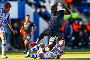 Colchester United defender (Captain) Luke Prosser (5) makes a tackle Lincoln City forward John Akinde (29) during the EFL Sky Bet League 2 match between Colchester United and Lincoln City at the JobServe Community Stadium, Colchester, England on 27 October 2018.