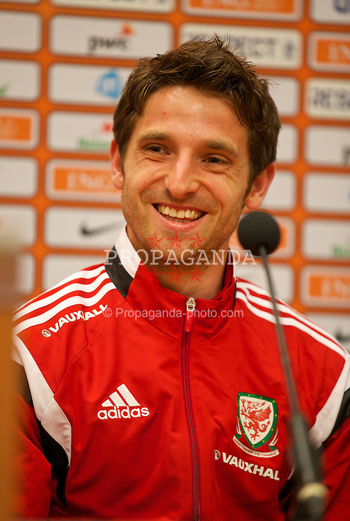AMSTERDAM, NETHERLANDS - Tuesday, June 3, 2014: Wales' Joe Allen during a press conference at the Amsterdam Arena ahead of the International Friendly match against the Netherlands. (Pic by David Rawcliffe/Propaganda)