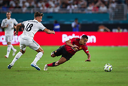 July 31, 2018 - Miami Gardens, Florida, USA - Manchester United F.C. forward Alexis Sanchez (7) falls as he disputes the ball with Real Madrid C.F. midfielder Marcos Llorente (18) during an International Champions Cup match between Real Madrid C.F. and Manchester United F.C. at the Hard Rock Stadium in Miami Gardens, Florida. Manchester United F.C. won the game 2-1. (Credit Image: © Mario Houben via ZUMA Wire)