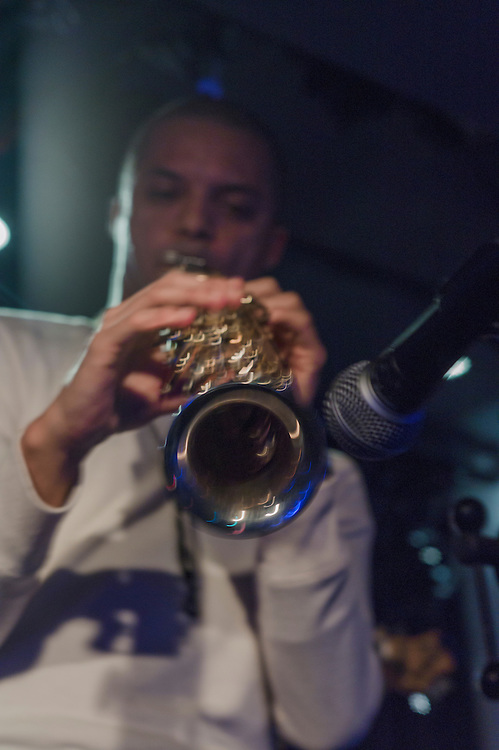 """Michael Robets on Sax with other musicians at a typiacal smal Tokyo Jazz club """"Absolute Blue"""" ."""