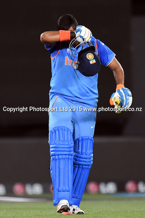 Indian batsman Suresh Raina celebrates his magnificient hundred during the ICC Cricket World Cup match between India and Zimbabwe at Eden Park in Auckland, New Zealand. Saturday 14 March 2015. Copyright Photo: Raghavan Venugopal / www.photosport.co.nz