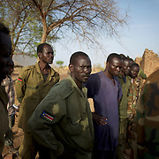 A group of Sudan People's Liberation Movement (SPLA-N) rebel fighters look at weapons and ammunition captured from Sudan's Armed Forces (SAF) during recent combats in the rebel-held territory of the Nuba Mountains in South Kordofan.