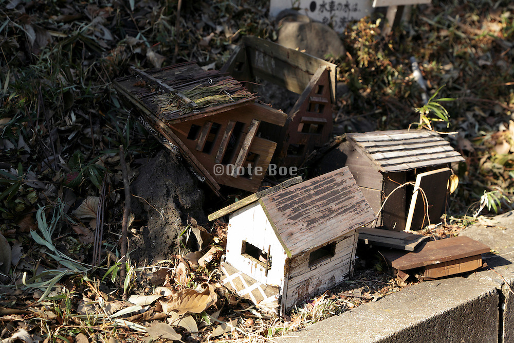 little wooden houses that are damaged