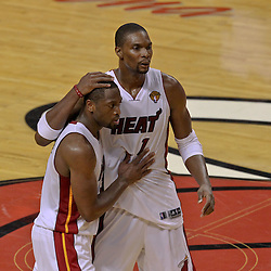 Jun 19, 2012; Miami, FL, USA; Miami Heat power forward Chris Bosh (1) and shooting guard Dwyane Wade (3) celebrate during the fourth quarter in game four in the 2012 NBA Finals against the Oklahoma City Thunder at the American Airlines Arena. Mandatory Credit: Derick E. Hingle-US PRESSWIRE