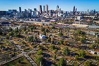 Historic Oakland Cemetery with Atlanta, Georgia, USA skyline and CSX train yard.