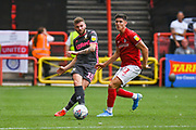 Stuart Dallas of Leeds United (15) passes the ball during the EFL Sky Bet Championship match between Bristol City and Leeds United at Ashton Gate, Bristol, England on 4 August 2019.