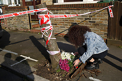 © licensed to London News Pictures. London, UK 01/03/2014. Mourners leaving flowers where two men, believed to be in their 20s, were found injured in a vehicle and later died in Leytonstone, east London on Saturday, 1 March 2014. Photo credit: Tolga Akmen/LNP