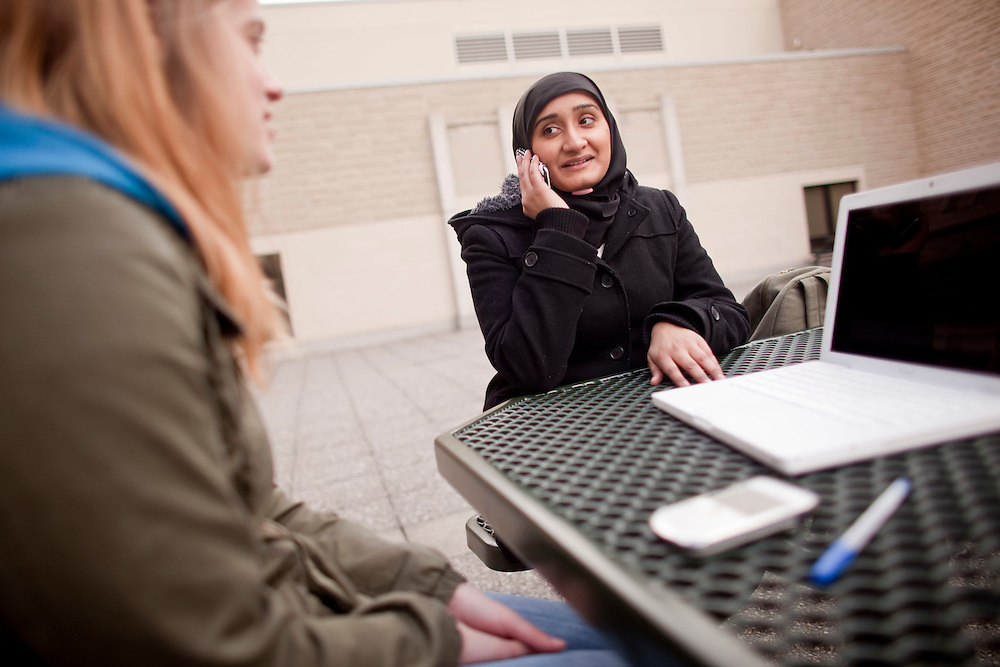London, Ontario ---11-04-05---  Awish Aslam, a second year political science student a the University of Western Ontario speaks on the phone during a break between classes and media interviews April 5, 2011. Awish was not allowed to attend a Conservative party rally in London on Sunday due to a facebook photo of her with Liberal leader Michael Ignatieff.<br /> GEOFF ROBINS The Globe and Mail