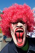 As clown costumed man. Carnival. Mindelo. Cabo Verde. Africa.