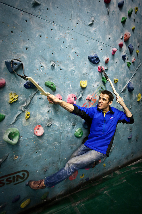 Tom Randall using the Schmoolz training tools at The Edge climbing wall in Sheffield.