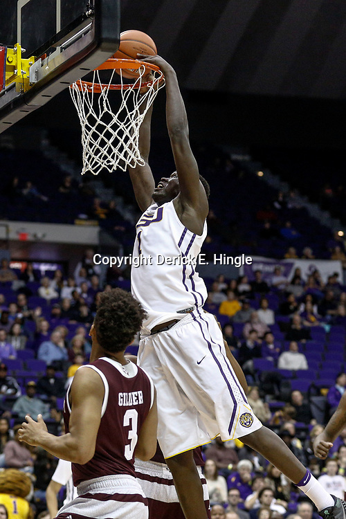 Feb 4, 2017; Baton Rouge, LA, USA; LSU Tigers forward Duop Reath (1) dunks over Texas A&M Aggies guard Admon Gilder (3) during the second half at the Pete Maravich Assembly Center. Texas A&M defeated LSU 85-73. Mandatory Credit: Derick E. Hingle-USA TODAY Sports