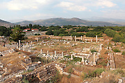 The Agora, Aphrodisias, Aydin, Turkey. The Agora was a large public market area with 2 long Ionic porticoes between the Temple of Aphrodite and the Acropolis. It was used mostly for musical events but also for public speaking and literature competitions. Aphrodisias was a small ancient Greek city in Caria near the modern-day town of Geyre. It was named after Aphrodite, the Greek goddess of love, who had here her unique cult image, the Aphrodite of Aphrodisias. The city suffered major earthquakes in the 4th and 7th centuries which destroyed most of the ancient structures. Picture by Manuel Cohen