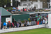 Spectators flood in to Lords via the North Gate as a heavy rain shower passes over which looks like it will delay the start of play on the final day at Lords ahead of the International Test Match 2019 match between England and Australia at Lord's Cricket Ground, St John's Wood, United Kingdom on 18 August 2019.