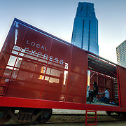 Prairie Logic boxcar performance venue at downtown Kansas City's Power and Light District green rooftop.