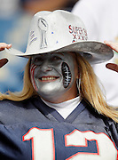 A New England Patriots fan sports her Super Bowl hat and painted face during the NFL regular season week 3 football game against the Buffalo Bills on September 26, 2010 in Foxborough, Massachusetts. The Patriots won the game 38-30. (©Paul Anthony Spinelli)