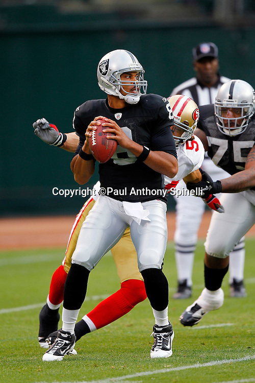 Oakland Raiders quarterback Jason Campbell (8) looks to pass the ball just before a blindside hit by San Francisco 49ers linebacker Travis LaBoy (54) during the NFL preseason week 3 football game against the San Francisco 49ers on Saturday, August 28, 2010 in Oakland, California. The 49ers won the game 28-24. (©Paul Anthony Spinelli)