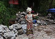 Posing in traditional Naxi clothing at Black Dragon Pool, in Lijiang, Yunnan, China; September, 2013.
