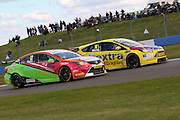 #14 Alex Martin - Dextra Racing with Team Parker, Ford Focus and #12 Mike Epps - RCIB Insurance Racing, Toyota Avensis challenge for position during the MSA British Touring Car Championship at Donington Park, Castle Donington, United Kingdom on 17 April 2016. Photo by Aaron  Lupton.