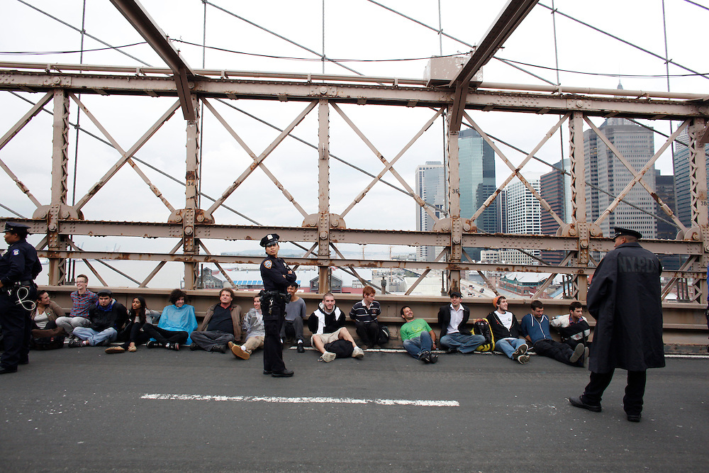 NOTE: These photos are uploaded on spec- please do not use without contacting- andrewhinderaker@gmail.com or 704-975-8795  Thank you...Caption: Occupy Wall Street march on the afternoon of Saturday, October 1, 2011, which ended with arrests of several hundred protesters on the Brooklyn Bridge after they marched on the car path.  Photo by Andrew Hinderaker.
