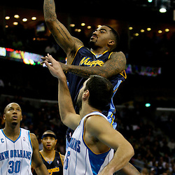 Dec 18, 2009; New Orleans, LA, USA; Denver Nuggets guard J.R. Smith (5) shoots over New Orleans Hornets forward Peja Stojakovic (16) during the second half at the New Orleans Arena. The Hornets defeated the Nuggets 98-92. Mandatory Credit: Derick E. Hingle-US PRESSWIRE