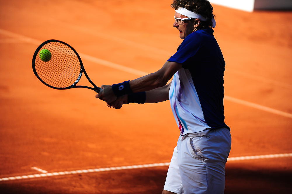 Duesseldorf, Germany. 23 May, 2014. Denis Istomin (UZB) returns the ball with a backhand during the semi final of the Duesseldorf Open at Rochusclub on Friday. Photo: Miroslav Dakov/ Alamy Live News