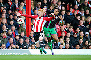 Brentford midfielder, Ryan Woods (15) battling for ball with Bristol City midfielder, Korey Smith (7) during the Sky Bet Championship match between Brentford and Bristol City at Griffin Park, London, England on 16 April 2016. Photo by Matthew Redman.