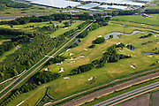 Nederland, Zuid-Holland, Zoetermeer, 23-05-2011; .Golfterrein Burggolflangs de A12 in Zoetermeer. Boven in beeld kassen. Golf  course along the motorway, greenhouses (top)..luchtfoto (toeslag), aerial photo (additional fee required).copyright foto/photo Siebe Swart