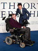 """Dec 9, 2014 - """"The Theory Of Everything"""" - UK Premiere - Red Carpet Arrivals at Odeon,  Leicester Square, London<br /> <br /> Pictured:  Professor Stephen Hawking; Eddie Redmayne<br /> ©Exclusivepix Media"""