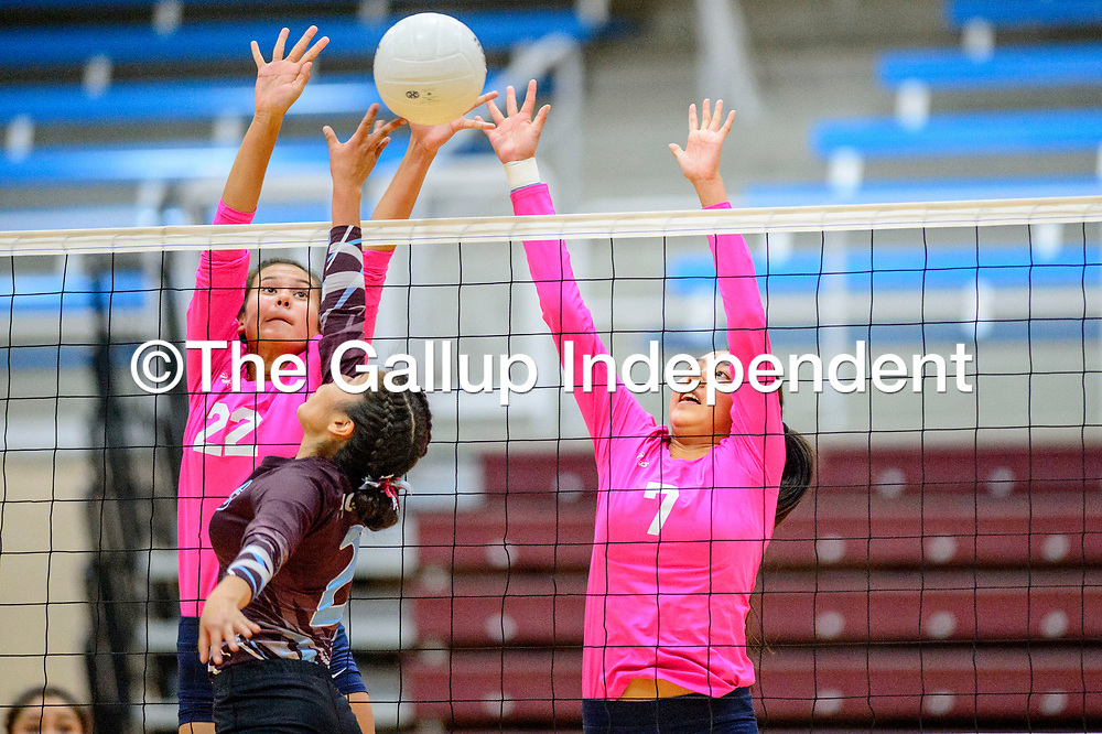 Window Rock Scouts Jana Solee (22), left, and Zeriyah James (7) attempt to block Ganado Hornet Tiara Cook (2) at Ganado High School in Burnside Tuesday.