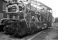 Burnt-out double decker bus which was hijacked on the Shankill Road, Belfast, N Ireland. September 1976. 197609000485c..Copyright Image from Victor Patterson, 54 Dorchester Park, Belfast, UK, BT9 6RJ..Tel: +44 28 9066 1296.Mob: +44 7802 353836.Voicemail +44 20 8816 7153.Skype: victorpattersonbelfast.Email: victorpatterson@me.com.Email: victorpatterson@ireland.com (back-up)..IMPORTANT: If you wish to use this image or any other of my images please go to www.victorpatterson.com and click on the Terms & Conditions. Then contact me by email or phone with the reference number(s) of the image(s) concerned.