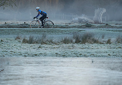 © Licensed to London News Pictures. 16/12/2017. London, UK. A cyclist makes his way through a frozen landscape in Richmond Park. Parts of the UK are experiencing freezing temperatures today with snow expected in parts. London, UK. Photo credit: Ben Cawthra/LNP