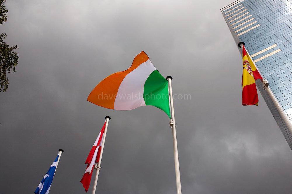 Irish flag blowing despite stormy weather, Brussels.