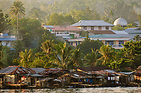 Water village at the harbour, Manokwari, West Papua, Indonesia. Manokwari is a small town on the north east coast of the Bird's Head Peninsula, West Papua, Indonesia.  Its harbour has many wrecks from WWII.