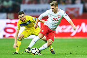Warsaw, Poland - 2017 September 04: (R) Lukasz Piszczek from Poland fights for the ball with (L) Aslan Darabayev from Kazakhstan during soccer match Poland v Kazakhstan - FIFA 2018 World Cup Qualifier at PGE National Stadium on September 04, 2017 in Warsaw, Poland.<br /> <br /> Adam Nurkiewicz declares that he has no rights to the image of people at the photographs of his authorship.<br /> <br /> Picture also available in RAW (NEF) or TIFF format on special request.<br /> <br /> Any editorial, commercial or promotional use requires written permission from the author of image.<br /> <br /> Mandatory credit:<br /> Photo by &copy; Adam Nurkiewicz / Mediasport